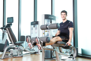 man exercising on leg extension machine